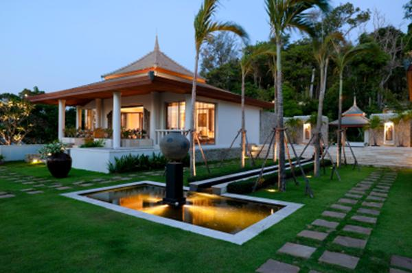 A modern garden design showing paving, water,  trees, lawn and lighting.