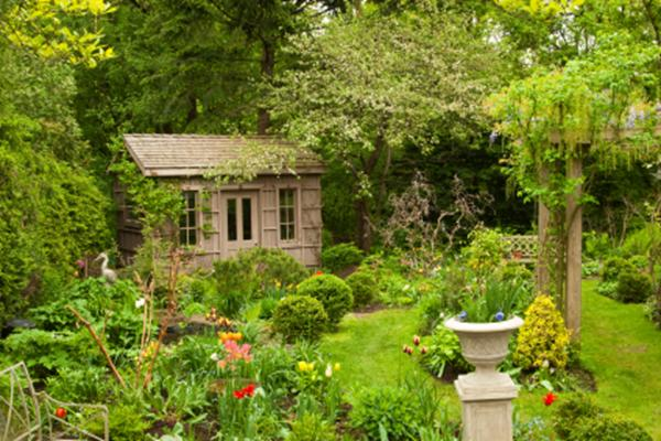 A nice shed in a very well planted and attractive garden.
